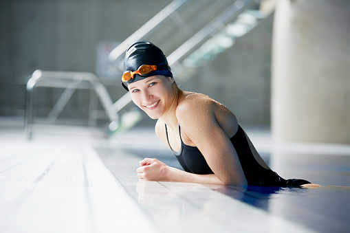 female swimmer smiling to camera in pool - gettyimageskorea