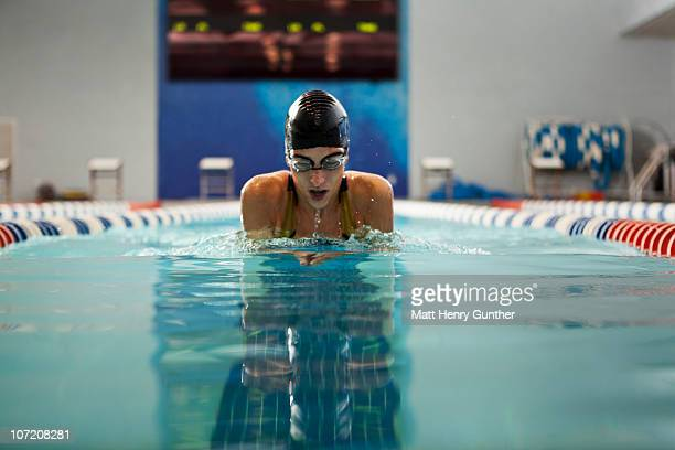 female swimmer swimming the breaststroke - length stock pictures, royalty-free photos & images