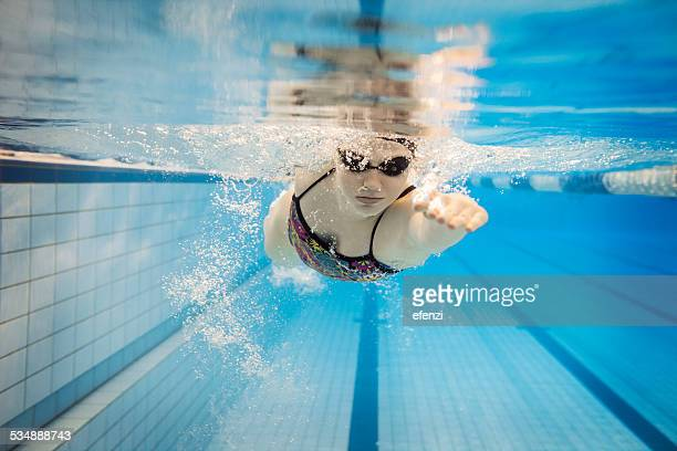 female swimmer underwater - swimming stock pictures, royalty-free photos & images