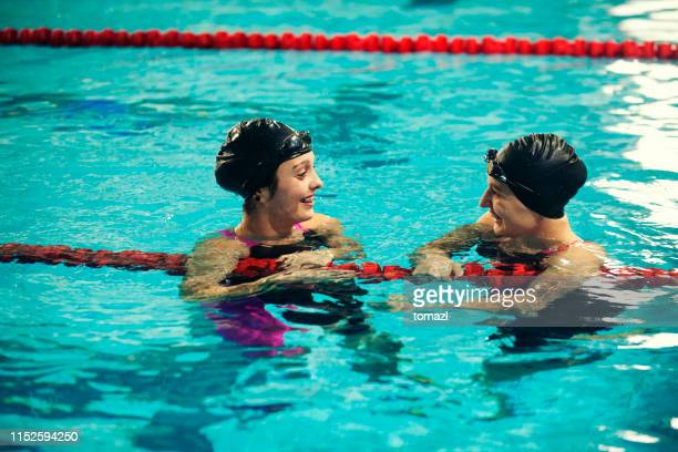 female swimmers congratulating for victory - competition group stock pictures, royalty-free photos & images