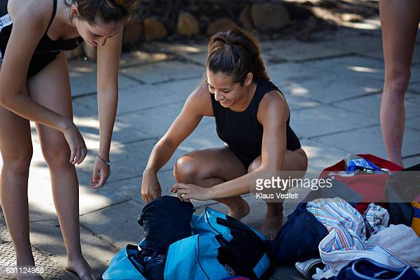 female swimmers getting ready for the pool - スポーツバッグ ストックフォトと画像