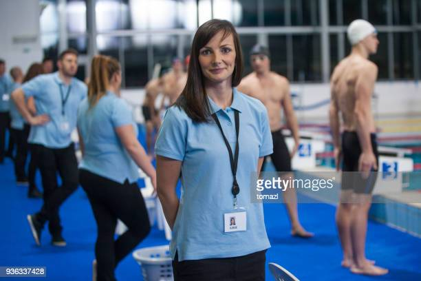 female swimming referee at competition before start - sports official stock pictures, royalty-free photos & images