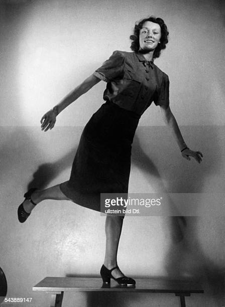 Female tapdancer on a table looking at the camera Photographer UMBO 1939Vintage property of ullstein bild