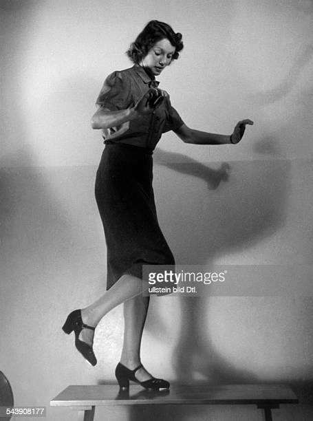 Female tapdancer on a table Photographer UMBO 1939Vintage property of ullstein bild