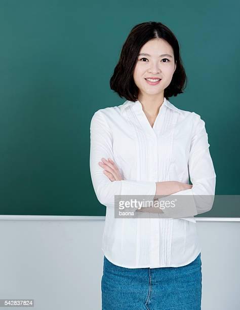 Female teacher in front of chalkboard