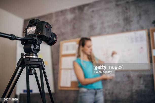 female teacher is recording classes on a digital camera - the media stock pictures, royalty-free photos & images