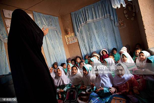 Female teacher leads pre-school children in song at a community-run childcare class in Injil district, outside Herat, Nov 29, 2011. There are more...