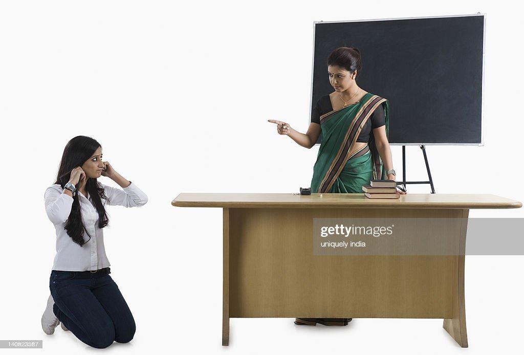 Teacher punishes student for bad grades 10