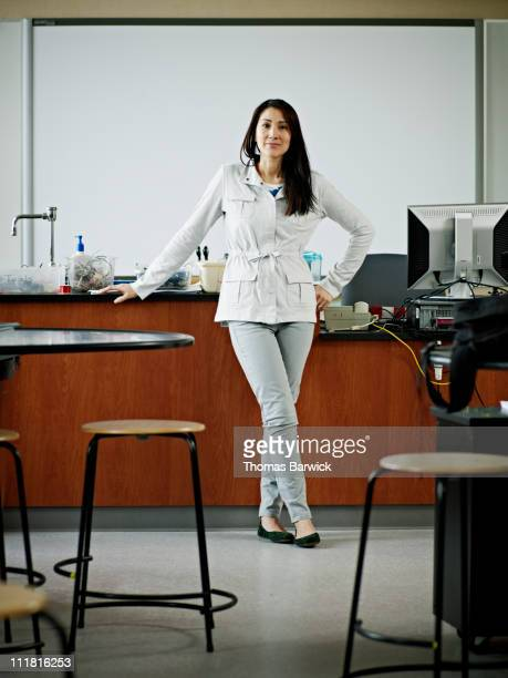 Female teacher standing in front of classroom