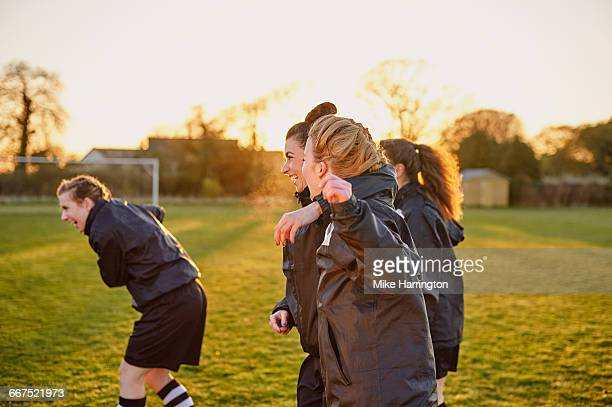 female team mates laughing together - team sport stock pictures, royalty-free photos & images
