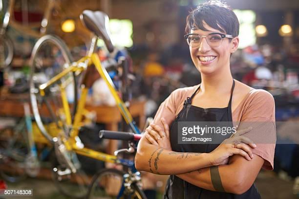 Female technician in her bicycle repair shop
