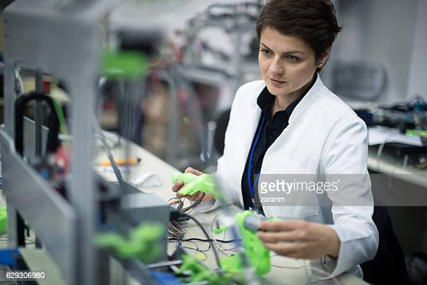 Female technician using a 3D printer