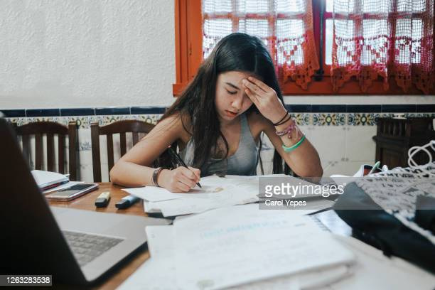 female teenager feeling stressed studing at home.e learning.home schooling - bad student stock pictures, royalty-free photos & images