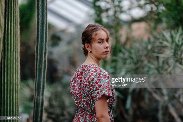 female teenager in botanical garden in bonn, germany - botanischer garten stock-fotos und bilder