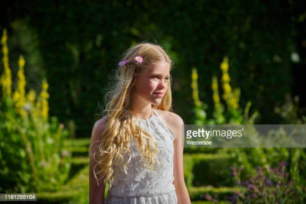 female teenager  in traditional religious confirmation dress - religious confirmation stock pictures, royalty-free photos & images