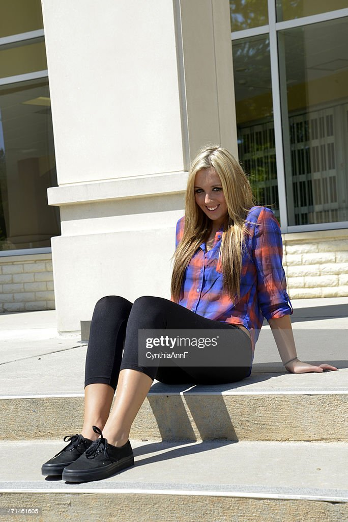 female teenager sitting on concrete steps : Stock Photo