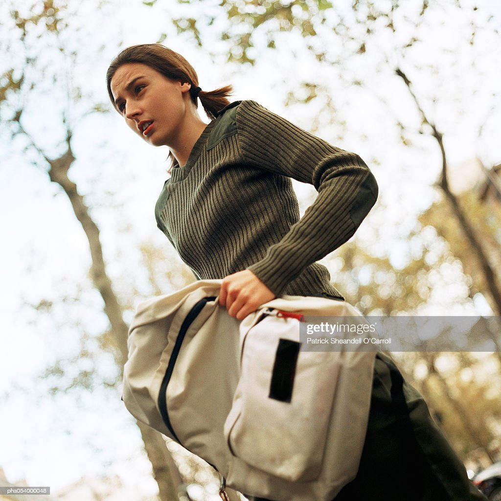 Female teenager with backpack : ストックフォト