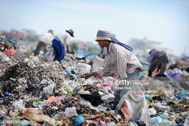 Female teenager works in Stung Meanchey slums where 2000 people live on garbage dump, and earn their money by selling recyclable garbage: Based on...