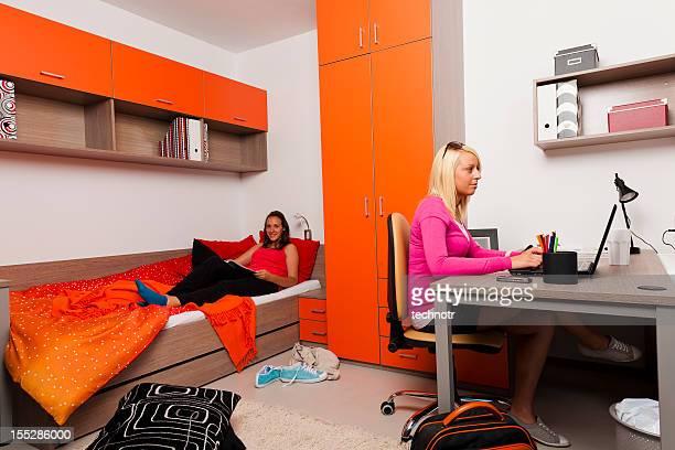 Female teenagers working in the dorm