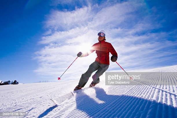 Female Telemark skier turning