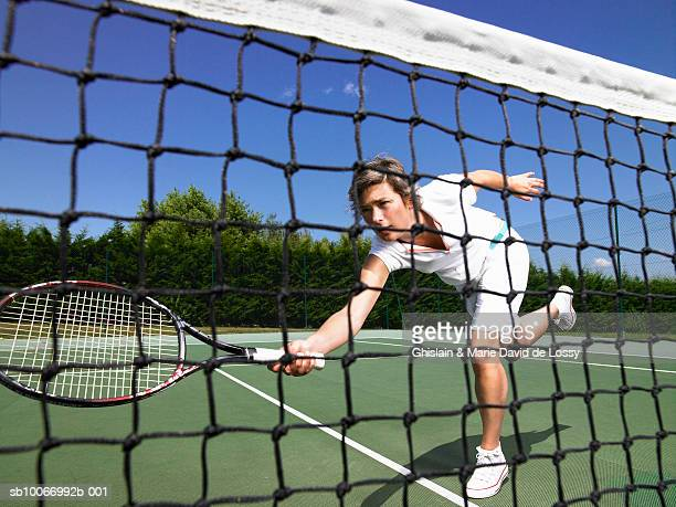 female tennis player attempting volley shot next to net - france strike stock pictures, royalty-free photos & images