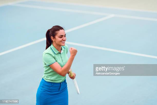 female tennis player happy when hard work pays off - tennis player stock pictures, royalty-free photos & images