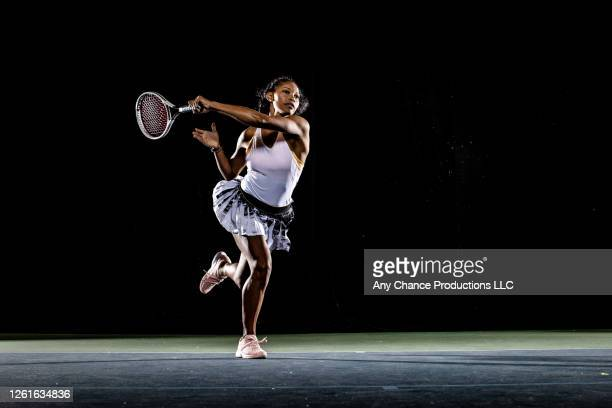 female tennis player hitting forehand shot - tennis player stock pictures, royalty-free photos & images