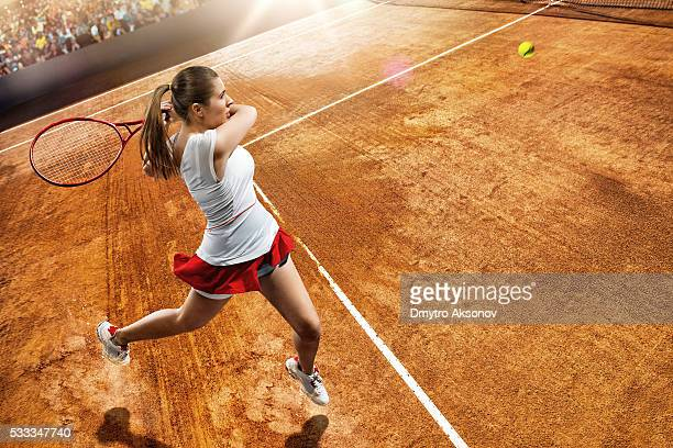 Female tennis player in action