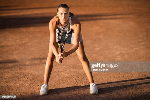 Female tennis player in ready position