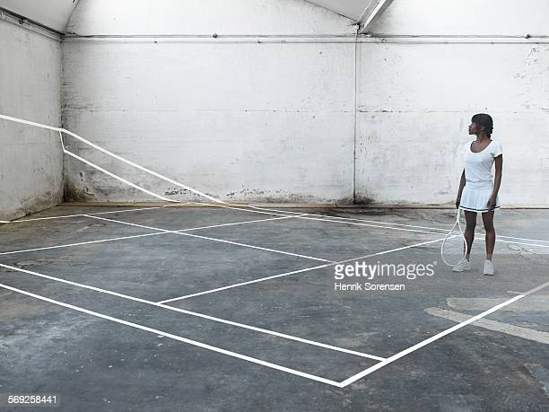 Female tennis player stand on tennis court