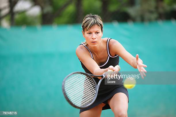 Female Tennis Player Swinging Forehand