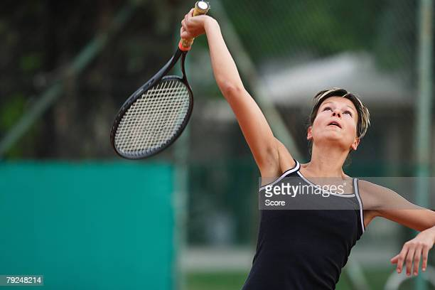 Female Tennis Player Swinging Racquet, Racket