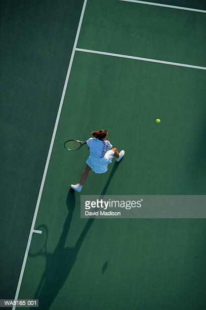 Female tennis player with backhand return, elevated view