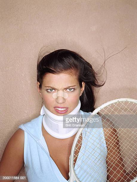 Female tennis player with plaster on nose, portrait
