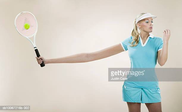 female tennis player with stretched out arm (digital composite) - einfachheit stock-fotos und bilder