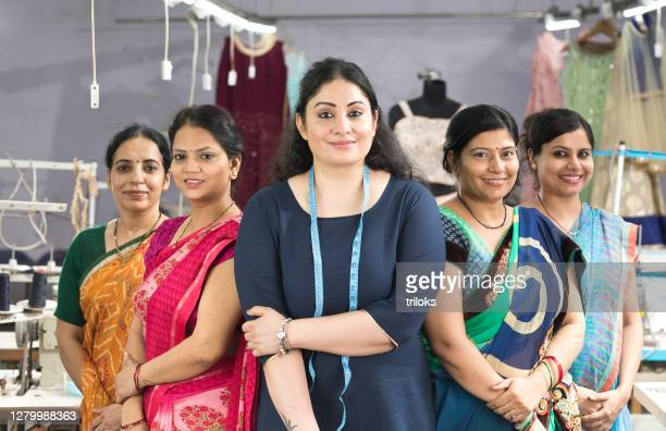 female textile workers standing together in solidarity at factory - indian culture stock pictures, royalty-free photos & images