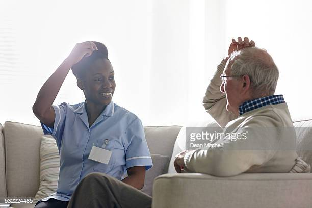 Female therapist carrying out EFT treatment with senior client
