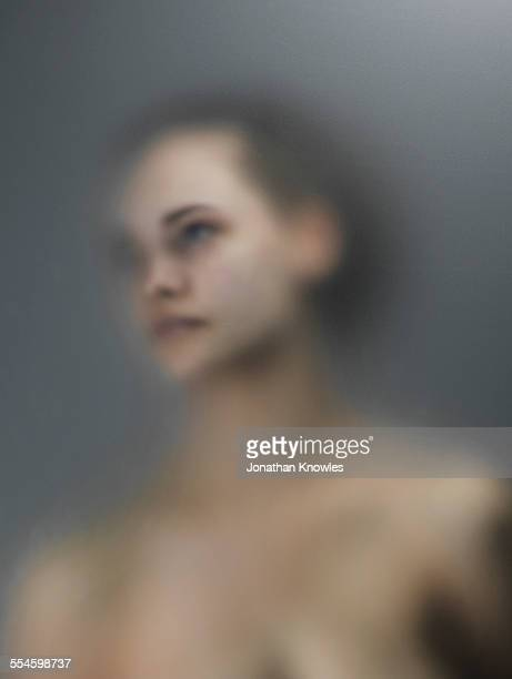 Female through frosted glass