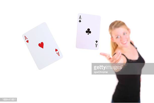 female throwing a pair of aces - hand of cards stock photos and pictures
