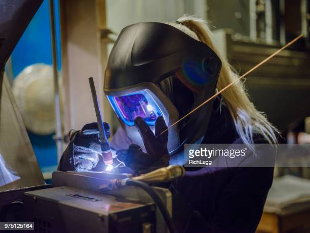 female tig welder - welding stock photos and pictures