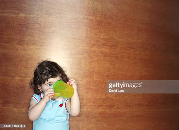 Female toddler (21-24 months) drinking from training cup