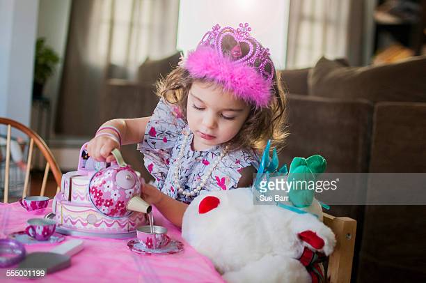 female toddler wearing princess crown at birthday party - princess stock pictures, royalty-free photos & images