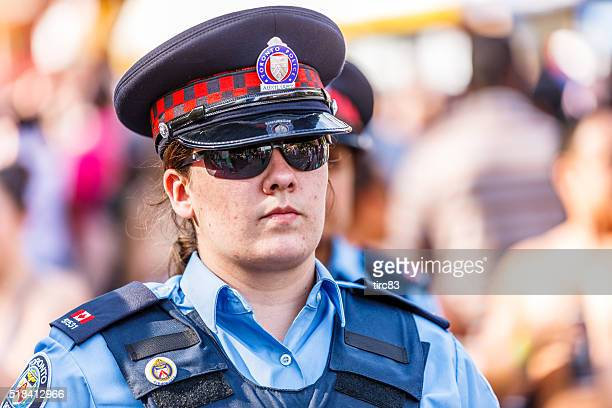 Female Toronto police officer on street patrol