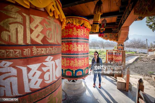 a female tourist at kyichu lhakhang temple, bhutan springtime - paro stock pictures, royalty-free photos & images