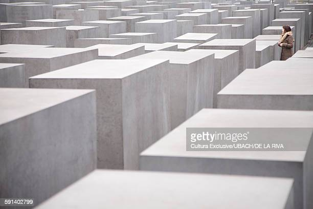 Female tourist at Memorial to the Murdered Jews of Europe, Berlin, Germany