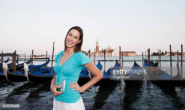 female tourist at st mark's square, venice, italy - hugh sitton stock pictures, royalty-free photos & images