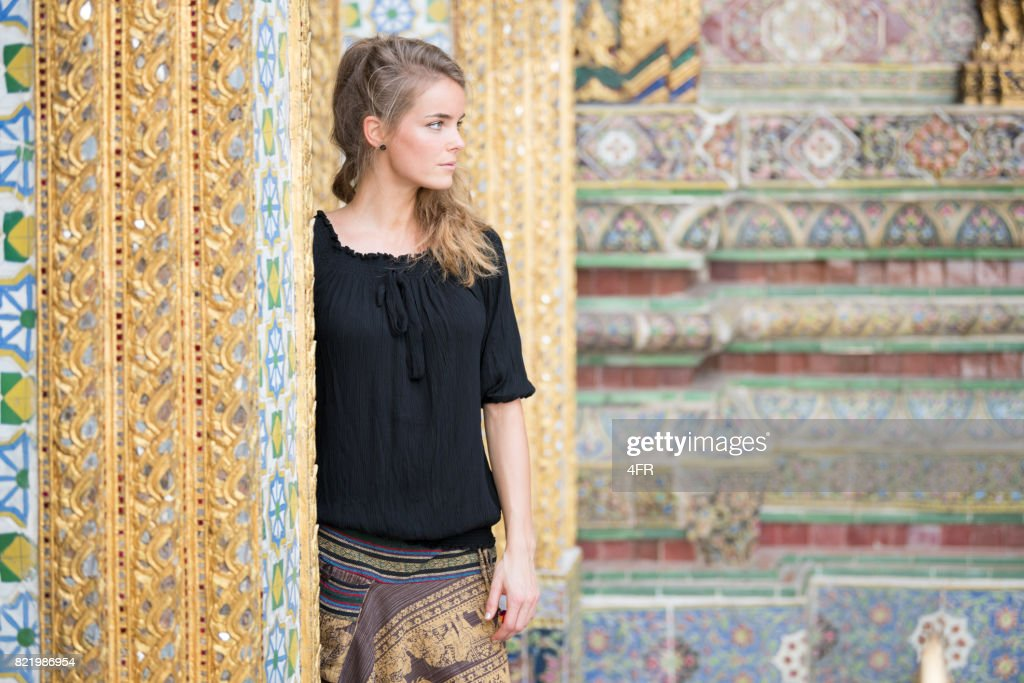 Female Tourist at the Grand Palace in Bangkok, Thailand : Stock Photo