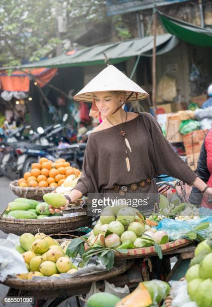 Female Tourist at the local Fruit Market, Hanoi, Vietnam