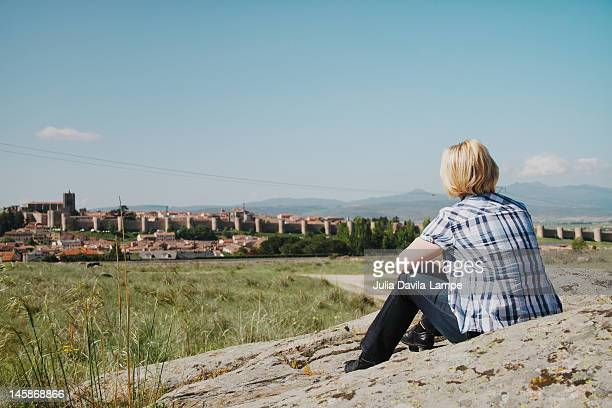 Female tourist contemplating Ávila, Spain