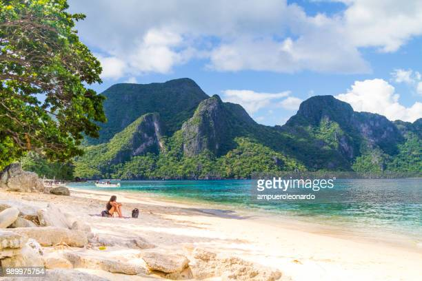 female tourist enjoying her vacations in el nido, philippines - el nido stock pictures, royalty-free photos & images